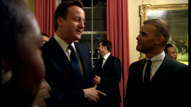 vidéos et rushes de david cameron says jimmy carr's tax arrangements are 'morally wrong'; lib downing street: int david cameron mp chatting to gary barlow at charity... - bbc children in need