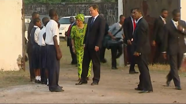 Monrovia Anna F Whisnant Elementary School EXT David Cameron MP along with Ellen Johnson Sirleaf and greeting students / Cameron and Sirleaf chatting