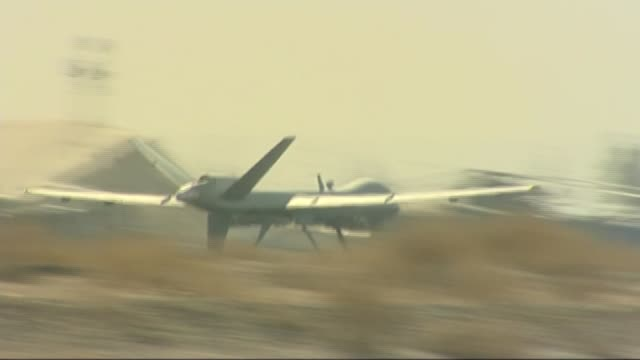 david cameron sets out his case for air strikes in syria in house of commons r02021009 / helmand province camp bastion ext unmanned raf drone... - heer stock-videos und b-roll-filmmaterial