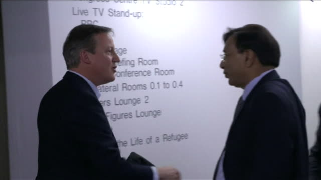 david cameron speaking to lakshmi mittal at the world economics forum in davos switzerland - communication stock videos & royalty-free footage