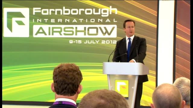 vídeos de stock e filmes b-roll de david cameron speech at farnborough air show england hampshire farnborough photography*** various gvs opening speech at podium / introduction of... - farnborough hampshire