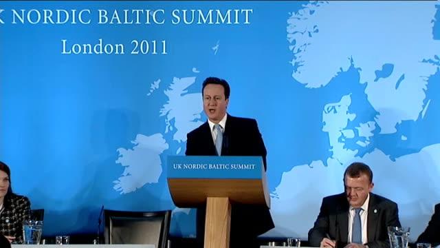 vídeos de stock, filmes e b-roll de david cameron speech at uk nordic baltic summit england london int david cameorn mp along to podium and drinking glass of water / david cameron... - vanguardista