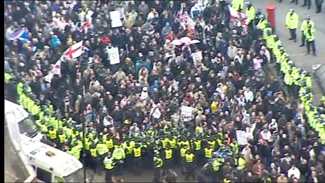 david cameron speech on multiculturalism / edl march in luton; air view / aerial edl supporters march through city centre streets with police escort - multiculturalism stock videos & royalty-free footage