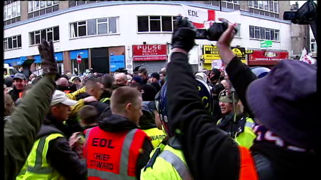 david cameron speech on multiculturalism / edl march in luton england bedfordshire luton ext riot police surrounding group of english defence league... - multiculturalism stock videos & royalty-free footage