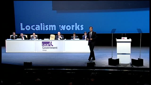 david cameron speech on public sector pensions reform; birmingham: int gv david cameron mp along to podium at lga conference gv audience applauding... - emotional stress stock videos & royalty-free footage