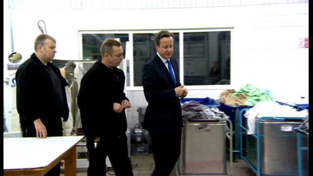 david cameron speech on punishment and rehabilitation of offenders; wormwood scrubs prison: david cameron touring prison laundry with prison officers - recovery stock videos & royalty-free footage