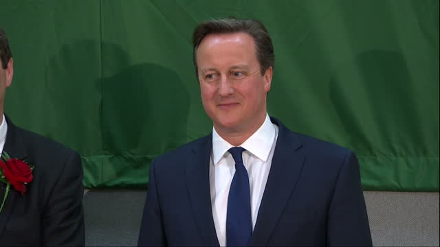 David Cameron the Conservatives win election Shows interior shots David Cameron walking onto the stage for the voting announcement vote count read...