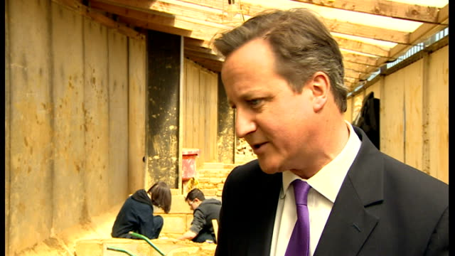 david cameron to deal with coalition row over schools budget; england: north london: harrow: int david cameron mp interview sot - of course in... - harrow stock videos & royalty-free footage