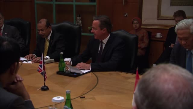 roundtable and speech indonesia jakarta photography** david cameron mp at infrastructure round table meeting / cameron into room for business... - round table discussion stock videos & royalty-free footage