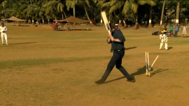 mumbai oval maidan ext david cameron mp batting and running during cricket match man bowling woman bowling cameron being bowled out cameron... - english language stock videos and b-roll footage