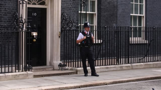 david cameron uk's outgoing prime minister leaves 10 downing street to attend his last questionandanswer session in the house of commons in london uk... - 2016年点の映像素材/bロール