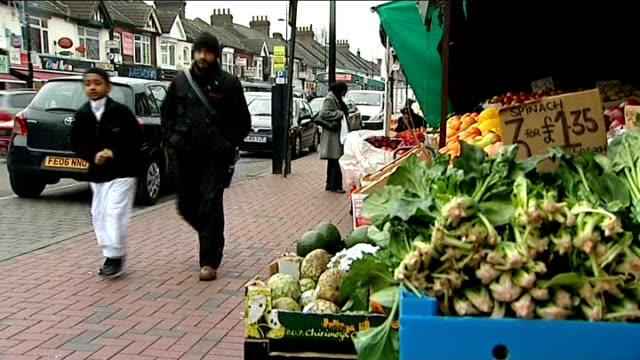 david cameron unveils immigration crackdown england ext man and young boy along past vegetable shop in asian migrant immigrant community area muslim... - lebensmittelhändler stock-videos und b-roll-filmmaterial