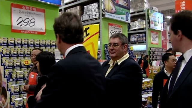 bq visit and speech beijing int cameron and others along on visit to bq store / cameron looking around store / cameron talking to store workers... - chancellor stock videos & royalty-free footage