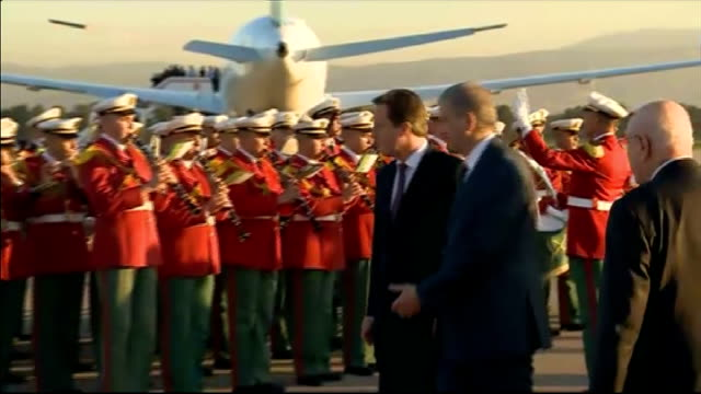 david cameron visit following hostage crisis arrival / wreath laying / interview algeria algiers ext david cameron mp along behind wreath being laid... - 花輪を捧げる点の映像素材/bロール
