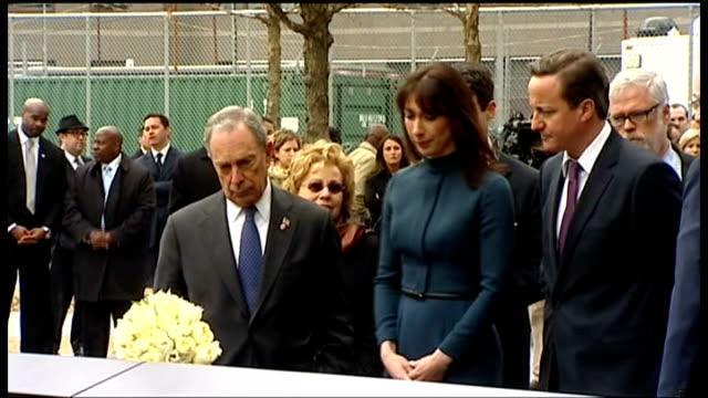 vídeos y material grabado en eventos de stock de ground zero visit; usa: new york: new york city: ext david cameron mp and michael bloomberg watching samantha cameron laying bunch of flowers on 9/11... - usa