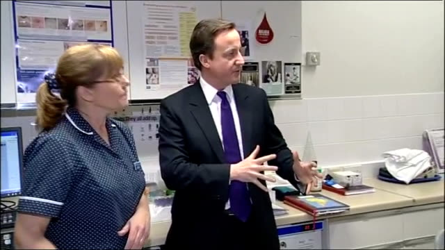 david cameron visit to a gps surgery in stroud gloucestershire stroud photography*** david cameron mp arrives at gps surgery and shake hands with... - overweight doctor stock videos & royalty-free footage