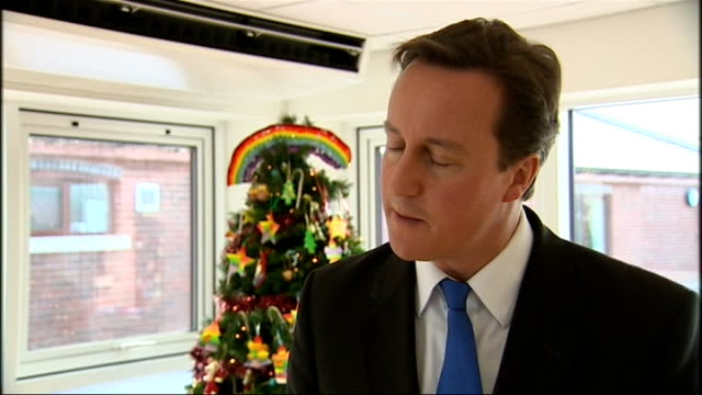 david cameron visit to rainbow's hospice in loughborough; cameron and lansley along with others on tour of facilities david cameron mp interview sot... - human back stock videos & royalty-free footage