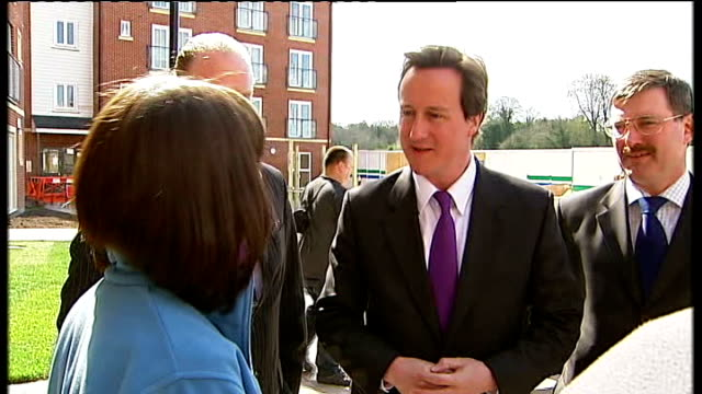 david cameron visits affordable housing development in chester england cheshire chester ext david cameron mp along with unidentified man past... - chester cheshire stock-videos und b-roll-filmmaterial