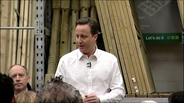 vídeos de stock, filmes e b-roll de david cameron visits bq store david cameron mp speech sot on what the govt going to spend / doe to spend on massage and contemplation sweet they do... - primary election