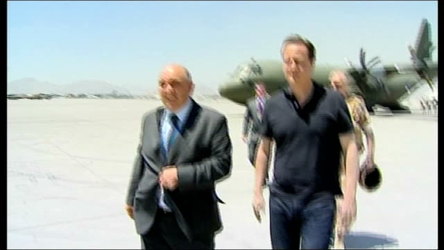 david cameron visits british troops afghanistan kabul ext david cameron mp out of plane as greets british military / cameron along with others... - polo shirt stock videos & royalty-free footage