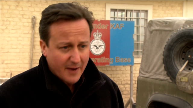vídeos de stock e filmes b-roll de david cameron visits british troops at kandahar airbase ext david cameron mp interview sot taken a range of steps like doubling the operational... - kandahar
