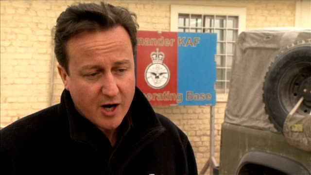 david cameron visits british troops at kandahar airbase: general views and interviews; david cameron mp interview sot - on military covenant and job... - kandahar stock-videos und b-roll-filmmaterial