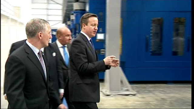 david cameron visits car plants in luton and northampton cameron and pickles along through factory / various shots of david cameron speech to workers... - northampton stock-videos und b-roll-filmmaterial