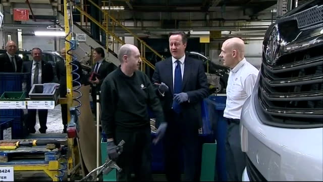 david cameron visits car plants in luton and northampton england luton vauxhall plant photography*** various shots of car workers working on vivaro... - northampton stock-videos und b-roll-filmmaterial