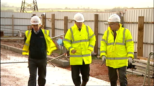 devon exeter photography*** david cameron mp arriving on visit at construction site int cameron chatting with project managers including looking at... - positive emotion stock videos & royalty-free footage