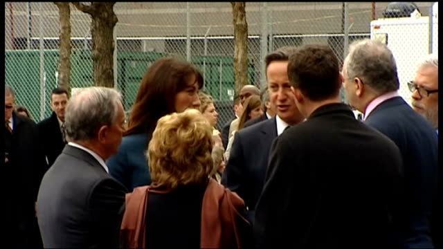 David Cameron visits Ground Zero Camerons' and Mayor walk beside memorial fountain and greet dignitaries / Samantha Cameron placing flowers on...
