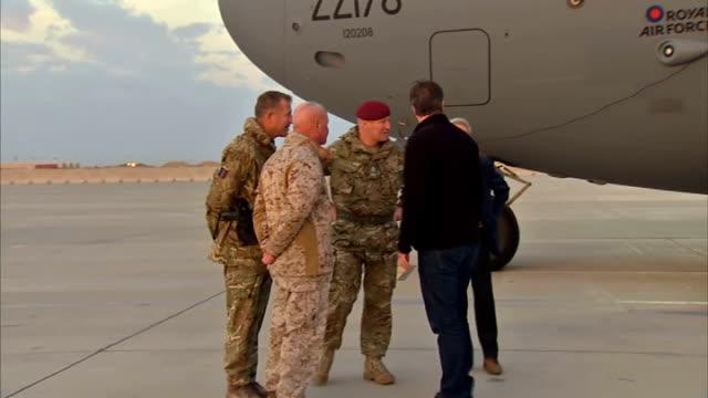 David Cameron visits Helmand Province and Camp Bastion AFGHANISTAN Camp Bastion EXT British Prime Minister David Cameron MP from RAF transport...