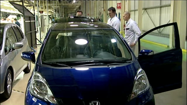 david cameron visits honda factory near swindon cameron looking at completed honda car / cameron across and talking to workers / honda production... - honda stock videos & royalty-free footage