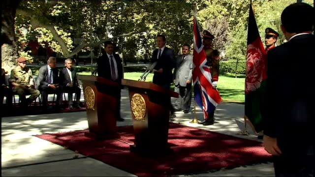 david cameron visits new president and british troops; kabul: air views city buildings cameron shaking hands with ashraf ghani cameron and ghani... - union army stock videos & royalty-free footage