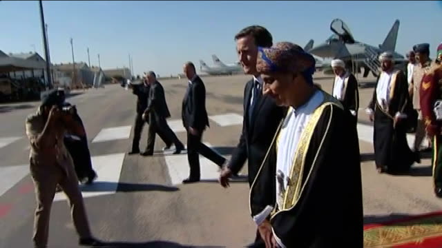 David Cameron visits Oman to announce defence deal OMAN Muscat EXT David Cameron MP along from plane and shaking hands with Sayyid Fahd bin Mahmoud /...