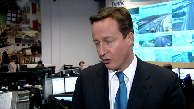david cameron visits rac traffic control centre; david cameron interview sot - i completely understand frustrations when christmas plans are sent... - emotional stress stock videos & royalty-free footage