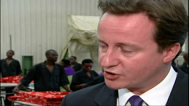 david cameron visits rwanda david cameron mp interview sot [on his decision to leave england despite the current floods there] i thought about it... - politische gruppe stock-videos und b-roll-filmmaterial