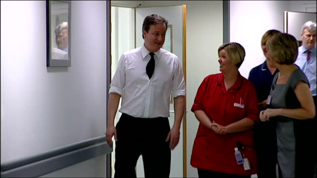 david cameron visits salford hospital / comments on anuj bidve murder cameron saying 'good morning' in corridor to unseen patient in room sot then... - soap sud stock videos & royalty-free footage