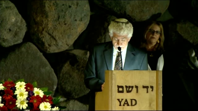 david cameron visits yad vashem jerusalem david cameron rekindling eternal flame in hall of remembrance / cameron laying wreath on slab where ashes... - 花輪を捧げる点の映像素材/bロール