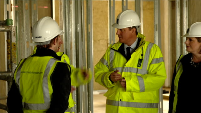 david cameron vistis 'help to buy' construction site england london photography** builders working on construction site as david cameron mp along as... - grundriss stock-videos und b-roll-filmmaterial