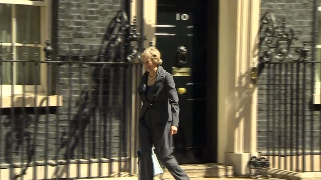 stockvideo's en b-roll-footage met david cameron's final day in office england london downing street ext theresa may mp out of number 10 after attending prime minister david cameron's... - prime minister