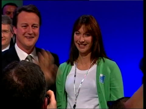 david cameron's wife gives birth to son; tx 4.10.2005 england: int sequence david cameron mp on stage at conservative party conference with wife... - mp点の映像素材/bロール