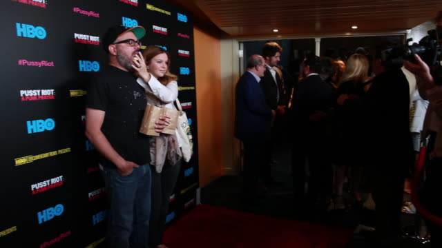 MS David Cross and wife Amber Tamblyn posing for paparazzi along the red carpet at Sunshine Cinema