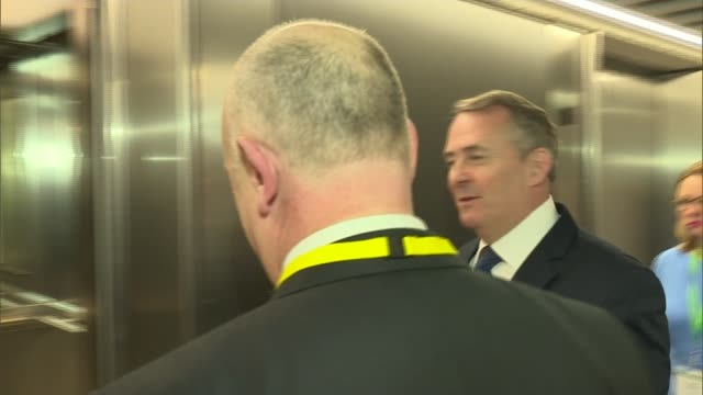 David Davis says postBrexit UK won't be a 'Mad Maxstyle' dystopia ENGLAND London INT Liam Fox MP along corridor and into lift then speaking to press...