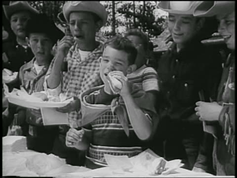 david eisenhower eating hot dog surrounded by other boys outdoors / colorado - 1954 stock videos and b-roll footage