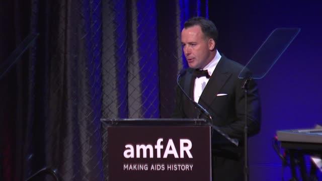 David Furnish presents an award at amfAR New York Gala To Kick Off Fall 2012 Fashion Week on in New York