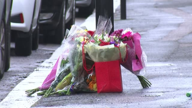nhs worker stabbed outside his home england london ext flowers left at the scene of the stabbing nhs worker david gomoh scene of the murder - crime and murder stock-videos und b-roll-filmmaterial