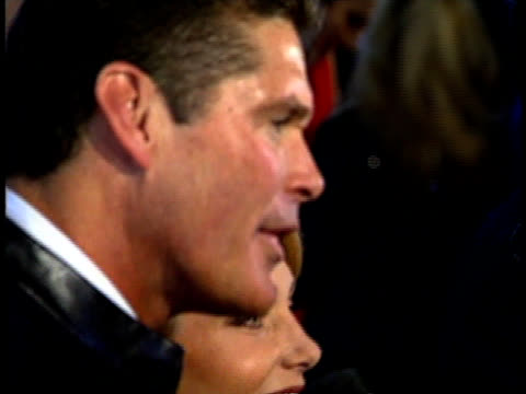 david hasselhoff and his wife, pamela bach speak to a reporter on the red carpet. - david hasselhoff stock videos & royalty-free footage