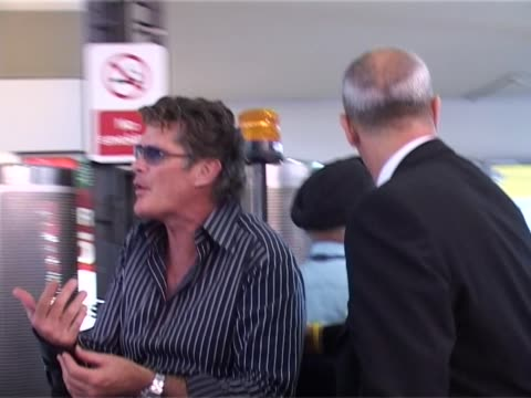 david hasselhoff departs to los angeles from heathrow after switching flights because of reported illness. - david hasselhoff stock videos & royalty-free footage