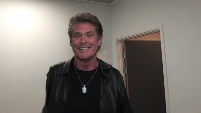 david hasselhoff in his dressing room before taking to the stage to perform a mini concert. david talks about britain's got talent, pantomime, his... - david hasselhoff stock videos & royalty-free footage