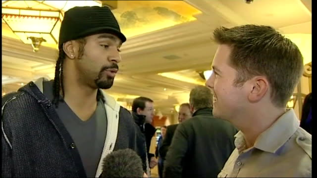 david haye interview sot amir is a good friend he's a world champion he's british amir khan posing with baby with some of interview overlaid sot - david haye stock videos and b-roll footage
